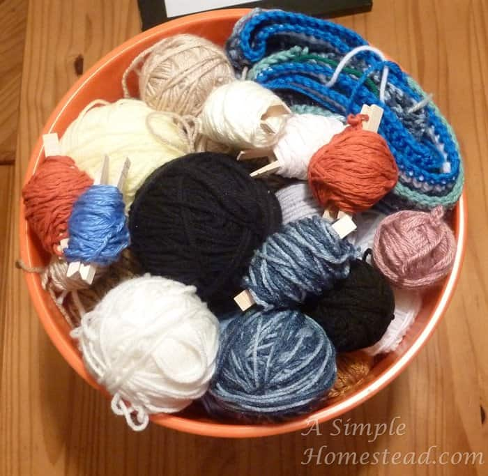yarn scraps organized with clothespins